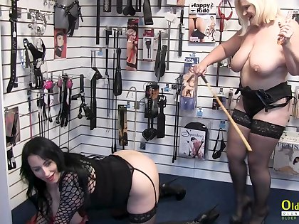Two mature lesbians got to sex shop to test some adult toys and masturbate together